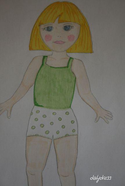 Magda wartet darauf, angezogen zu werden